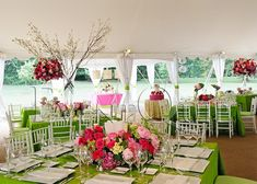 Green table linens with pink flowers and white plates :) very pretty and fun!