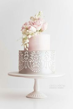 DeLaCreme Studio:  A sweet bouquet of sugar roses cascading down the cake.  Wedding.