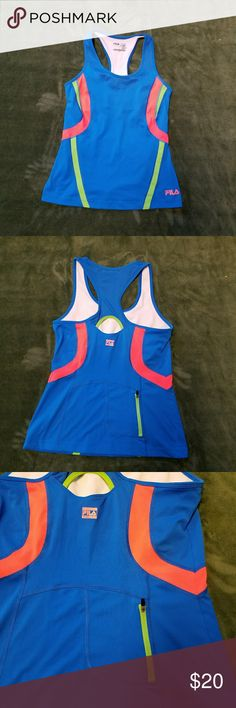 """Sport Fila Yoga Gym Workout Fitness Running Top M Top is blue with lime green and orange bands around armhole. I believe that this may have a reflective quality, however I'm not positive.  Very stylish running top by Sport Fila. Vented. Keyhole back. Zippered Pocket on backside of top. No rips, snags, stains or repairs.  Minimal pilling on inside built in shelf bra. Sz M measures 30"""" bust, 36"""" around waist (bottom hemline), 24"""" overall length. (Bin2) Tops Tank Tops"""