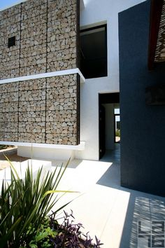 Casa Gavion- love the concept of the breathing wall.