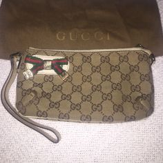 Final sale! Gucci wristlet 100% authentic Gucci wristlet... Used signs of wear on all corners of bag shown in pictures... Inside is very clean! Gold hardware does have scratches... Leather strap does show signs of wear... Gucci Bags Clutches & Wristlets