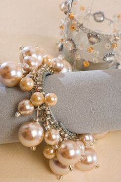 Pearl napkin rings - this is what I picture @Judith B Kemmerling