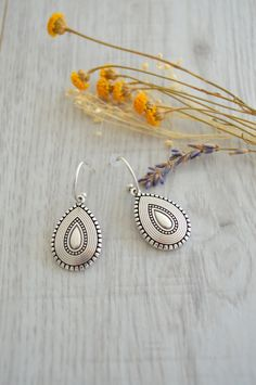 Item details: These lovely tribal earrings are beautifully designed with silver Turkish inspired, engraved teardrop shaped charms that dangle on silver earring hooks. If you want to adorn yourself with an affordable Turkish style jewelry, these earrings are perfect! They are