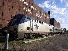 Train passing by Metropolitan Warehouse Storage near MIT.