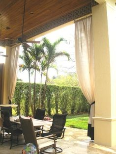 Outdoor spaces decorated with drapery.