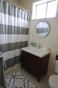 "i like the grey shower curtain and rug, not to mention the whole ""new meets old"" vibe of this bathroom."