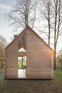 Dutch architecture firm Zecc Architecten teamed up with interior designer Roel van Norel to create an idyllic cottage in the countryside near Utrecht. With its gabled slate roof and four continuous walls, the quintessential cottage could leap from. Cabins In The Woods, House In The Woods, Residential Architecture, House Architecture, Chinese Architecture, Futuristic Architecture, Casas Containers, House Plans, Cabin Plans