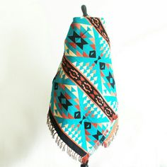 Coachella wrap - turquoise The perfect southwest print wrap for all your summer shenanigans. It will keep you warm when the sun sets on the Coachella Valley, keep you sand free at the beach, and make you instantly chic on a picnic with your love. Approx 4' x 5' Vera Lyndon  Accessories Scarves & Wraps