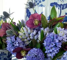 """""""I love the odd coloring of hellebores and think their coloring adds a level of sophistication to the clearer colors. The smokey blue grey of the thistle works as a lovely foil as well"""" - Carolyne Roehm... http://carolyneroehm.com/2013/04/12/the-first-somewhat-spring-dinner-of-the-season/"""
