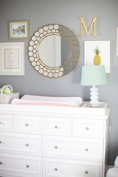 A gray, gold, and white nursery. Subtle but classy. Would look darling with Caden Lane's Lilac & Gold sparkle changing pad cover!