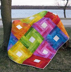 Rainbow Rail Fence Quilt Tutorial | This beautiful rainbow quilt has us dreaming of warmer weather!