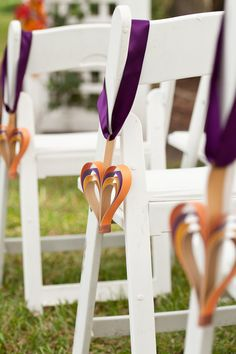 Loved the paper heart design hanging from the Chairs for Tracy and Uriel's Wedding
