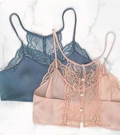 The perfect amount of sexy in one crop top. STYLIST TIP: Pair this Satin Lace Slate top with high waisted shorts, a simple dainty necklace, and your favorite gladiator wrap-up sandals. DETAILS: - 40%