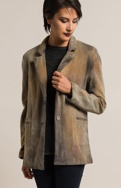 $1,190.00   Avant Toi Merino Wool/Cashmere Felted Blazer in Caramel Brown   Avant Toi clothing, by Mirko Ghignone, is avant garde and elegant. It is created by using experimental hand-dyeing and processing on fine fabrics and textiles. The line crosses into elegant and artistic with a grungy aesthetic. This tan cashmere blazer is simple yet textural in color. Avant Toi is sold online and in-store at Santa Fe Dry Goods & Workshop in Santa Fe, New Mexico.