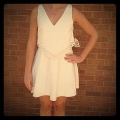 ⭐️ SALE ⭐️Unique Winter White Dress  Winter white dress in super cute style. Brand new with tags!!! Perfect for spring or summer! 92% polyester 8% spandex Altar'd State Dresses