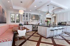 The sleek simplicity of this kitchen balances an elaborate floor.