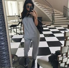 Changing it up: While the teen was dressed in just a barely-there one piece swim suit for the shoot, afterwards she covered up in a sweatsuit onsie