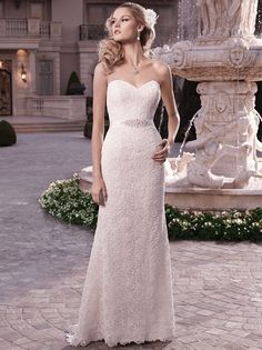 Casablanca Bridal Fall 2013, Style 2131 - Strapless sweetheart neckline with a non-beaded Matte Guipure Lace overlay. This sheath gown includes a detachable beaded ribbon sash and has crystal buttons along the zipper. Not crazy about the fabric but I like the overall shape and train.