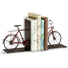 Cyan Design Pedal Bookends ($80) ❤ liked on Polyvore featuring home, home decor, small item storage, decor, bicycle sculpture, bicycle bookends, cyan design e wire sculpture