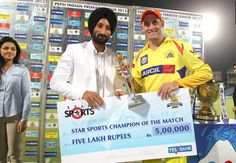 Mr Sardar Singh Captain of the Indian National Hocket Team presents the Star Sports Champion of the Match Award to Michael Hussey of Chennai Super Kings during the qualifier 1 match of the 2013 Pepsi Indian Premier League between The Chennai Superkings and the Mumbai Indians held at the Feroz Shah Kotla Stadium, Delhi on the 21st May 2013