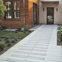 The clean lines and smooth faces of these long, narrow pavers make a fine complement to a contemporary exterior. | Photo: Stepstone | thisoldhouse.com