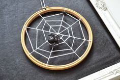 diy spiderweb hoops 50 SPOOKtacular DIY Halloween Decorations For the House and the Party