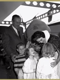 Walt on the monorail platform of the Disneyland Hotel—OMG, look at the look of pure delight on that little girl's face, and then look at how happy Walt is seeing how much the kids are enjoying meeting Snow White and Doc!!