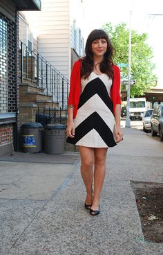 Bold chevron dress with a bright red cardigan