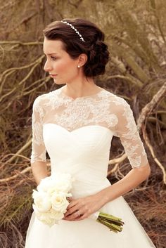 Sweetheart-neckline chiffon gown with sheer lace sleeves.