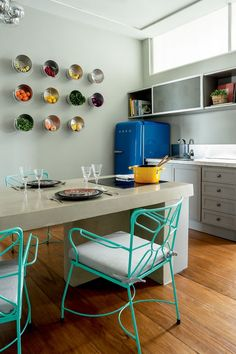 Triplex apartment architecture (Photo: Ricardo Labougle), The kitchen, with table designed by Triplex Architecture, has welcomed chairs Herrero Antiquarian, smeg
