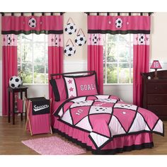 Give your little goalie the perfect room theme with this bold soccer bedding set from Sweet Jojo Designs. Soccer balls and stars adorn this set, complete with a black contrast trim and pink accents.