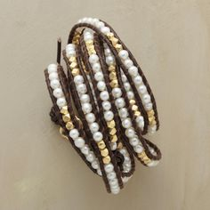 "LUNAR LADDER 5 WRAP BRACELET -- Incandescent pearls and 14kt gold vermeil beads glimmer and glow between strands of chocolate brown leather which wrap round and round your wrist. Button closure. Handcrafted by Chan Luu. 32""L."