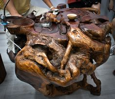 This is the coolest tea table I've ever seen. It's actually made from a tree trunk. I would love to get one of these for myself.