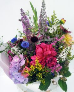 Early August.  Designers choice prearranged for you to put in your vase.  Must be pre-ordered.