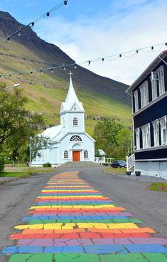 The Blu Church in Seyðisfjörður, East Iceland.  Seyðisfjörður, a fjord skillfully carved by the ice age glacier, is distinguished by excellent harbour facilities and Norwegian heritage. Seyðisfjörður has been an important trading center from the nineteenth century up to modern times, due to natural harbor and proximity to the european continent. The colourful, Norwegian-style wooden houses, dating from the early years of the 20th. century render this village unique in Iceland.