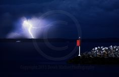 Lightning striking Moreton Island, photographed from Redcliffe in Queensland, Australia.  For image licensing enquiries, please feel welcome to contact me at derekwalker73@bigpond.com  Cheers :)
