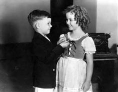 Billy Clark deputizing Shirley Temple, 1935
