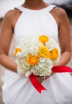 Bouquet by Bells & Whistles http://www.outerbanksweddingassoc.org/membersearch/memberpage.html?MID=1946=Florals=12