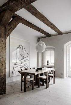 A industrial building is transformed into a serene, contemporary townhouse that still connects with its past life by retaining original features such as the exposed timber beams and arched windows. Rooms Ideas, Timber Beams, Exposed Beams, Living Comedor, Dining Room Lighting, Slow Living, Architectural Elements, Room Set, Interiores Design