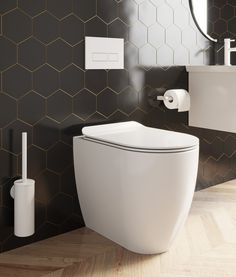 Ideal for any contemporary bathroom scheme, our new MPRO Matt White finish works perfectly with either crisp monochrome tones or as the neutral centrepiece to a more colourful palette. #bathrooms #bathroominspiration #whitebrassware #whitetaps #blackbathroomideas #darkbathrooms Dark Bathrooms, Wall Mounted Toilet, White Shower, Toilet Roll Holder, Toilet Brush, White Towels, Bathroom Inspiration, White Walls, Bathroom Accessories