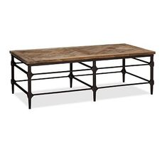 The reclaimed wood look would be a great way to add a western feel without being too rustic. Parquet Reclaimed Wood Rectangular Coffee Table #potterybarn