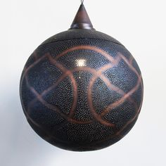 Antiqued copper globe lantern with perforated moorish design patterns that shine beautiful patterns onto walls and ceiling.