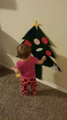 Use felt to make a Christmas tree for the little one to decorate. My 16 month old loves it
