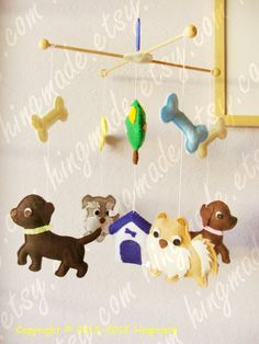 Dogs mobile - Pet Mobile - Puppy Baby Mobile - Custom mobile featuring your pets and their friends. Pick your colors and accessories. $95.00, via Etsy.