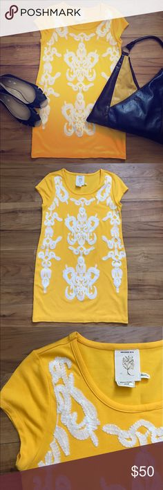 Anthropologie Meadow Rue Yellow Dress Beautiful Anthropologie Meadow Rue golden yellow shift dress with soft white appliqué design on the front. Rayon, polyester & spandex. Imported from London. Excellent condition! Anthropologie Dresses