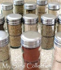 Beach sand in spice jars. Cute idea to have a wall spice rack in the bathroom to show off my display
