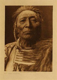 Bull Tongue (Tsidup-teshish) (c. 1838 - ? ) - Apsaroke (Crow) warrior - Photo by Edward S. Curtis - 1908 - (Original)