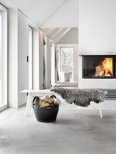 15 impeccable examples of sophisticated interiors with concrete floors - Heike Vogelsang - 15 impeccable examples of sophisticated interiors with concrete floors Scandinavian interior with concrete floor. Torkelson via Femina - Swedish Decor, Swedish Style, Concrete Interiors, Rustic Interiors, Beton Design, Home Fireplace, Fireplaces, Linear Fireplace, Fireplace Cover