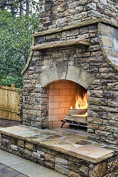 Stunning outdoor fireplace... could maybe integrate a woodfire pizza oven? :)
