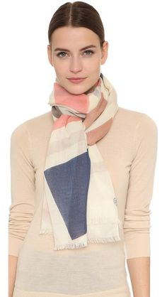 Tory Burch Exploded Fret Oblong Scarf, so you cal look cool while you stay warm.